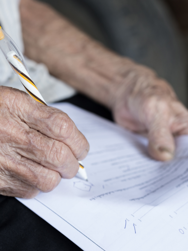 Elderly person filling out the questionnaire.